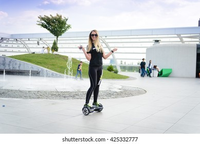 BUCHAREST, ROMANIA, - April 10, 2016: Using hoverboard, a self-balancing two-wheeled board. The gyroscope based dual wheel electric scooter is also called a smart balance wheel.