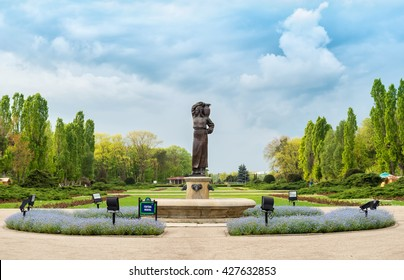 Bucharest, Romania - April 12, 2016: The Modura Fountain in Herastrau Park, describing a woman wearing a romanian traditional costume and holding a jug on her shoulder
