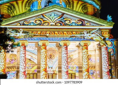 BUCHAREST, ROMANIA - APRIL 14, 2018: Romanian Athenaeum (Ateneul Roman) Lights At Night During Spotlight Bucharest International Light Festival