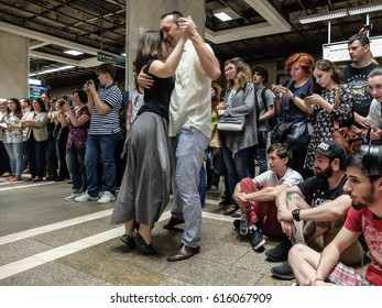"""BUCHAREST, ROMANIA, April 18, 2016: People are dancing during the """"Art does not bite"""" free urban spectacle in Piata Unirii metro station in Bucharest, in order to get the public close to the arts."""