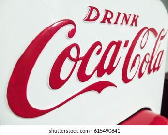 BUCHAREST, ROMANIA, April 19, 2016: Coca-Cola brand logo on a metal plate.