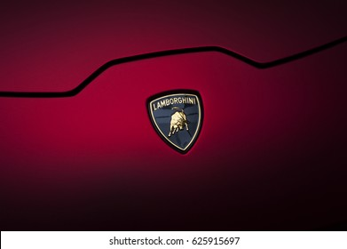 BUCHAREST, ROMANIA - April 21 2017 Lamborghini Huracan Cherry Red Chrome Matt Sign Close Up