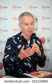BUCHAREST, ROMANIA- APRIL 24: John McEnroe speaks to the media and gestures during BRD Nastase Tiriac Trophy press conference, on April 24, 2012, at Arenele BNR, in Bucharest, Romania