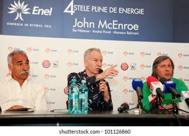 BUCHAREST, ROMANIA- APRIL 24: Mansour Bahrami, John McEnroe, Ilie Nastase, tennis legends, speak to the media during BRD Nastase Tiriac Trophy press conference, on April 24, 2012 in Bucharest, Romania