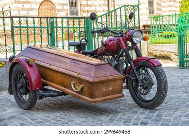 BUCHAREST, ROMANIA - APRIL 25, 2015: Coffin carried by a vintage motorcycle with sidecar