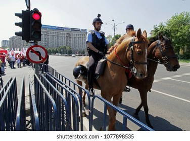 Bucharest, Romania - April 26, 2018: Romanian Gendarmerie Cavalry patrols, during a protest of health workers, in Victoria Square, in Bucharest.
