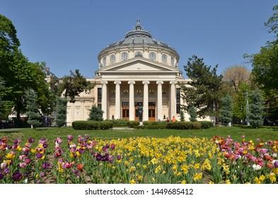 "Bucharest, Romania - April 26, 2019:   Romanian Athenaeum concert hall, landmark of Romanian capital city and home of ""George Enescu"" Philharmonic on a beautiful sunny spring day."