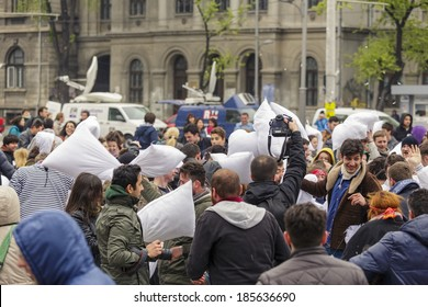 BUCHAREST, ROMANIA - APRIL 5: Large group of unidentified people gather and have fun at annual International Pillow Fight Day on April 5, 2014 in University Square, Bucharest, Romania.