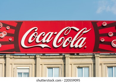 BUCHAREST, ROMANIA - AUGUST 06, 2014: Coca-Cola Advertising On Apartment Building. It  is a carbonated soft drink sold in stores and restaurants in every country except Cuba and North Korea.