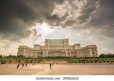 BUCHAREST, ROMANIA - August 08, 2014: Palace of Parliament on August, 2014 in Bucharest, Romania, visited by tourists. The worlds largest civilian building, the most expensive administrative building.