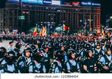 Bucharest, Romania - August 10, 2018: Heavy protesting in front of the government protected by law enforcers
