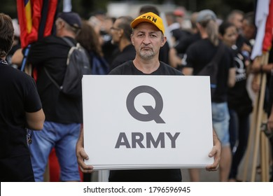 Bucharest, Romania - August 10, 2020: People display Qanon messages on cardboards during a political rally.