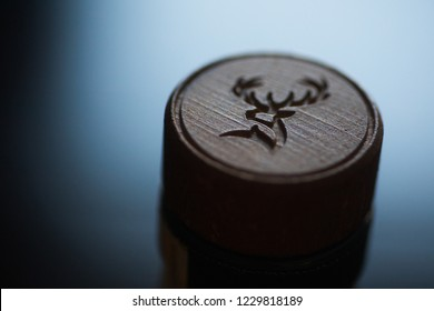 Bucharest, Romania - August 13, 2018: Illustrative-editorial detail on the stopper of a Glenfiddich whisky bottle, in Bucharest, Romania. Glenfiddich is a single malt Scotch whisky brand.