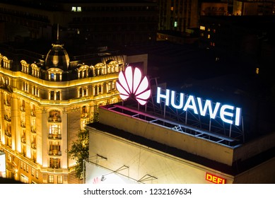 Bucharest, Romania - August 13, 2018. A Huawei advertisement on the roof of a building in central Bucharest.