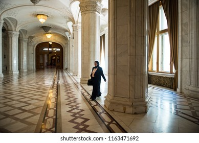 Bucharest, Romania - August 14, 2018. A tourist walks inside the Palace of Parliament. The Palace of Parliament is the second largest administrative building in the world after The Pentagon.