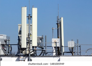 Bucharest, Romania - August 14, 2019: Many GSM telecommunications antennas are installed dangerously very close to the apartments located in a building in Bucharest. Image for editorial use only.