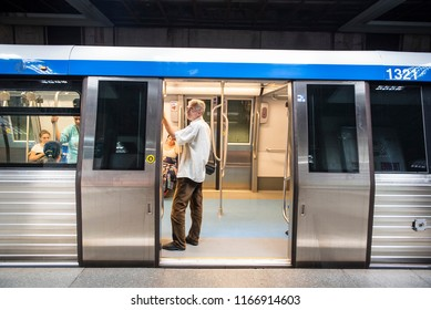 Bucharest, Romania - August 15, 2018. People inside a train at a metro station in central Bucharest.
