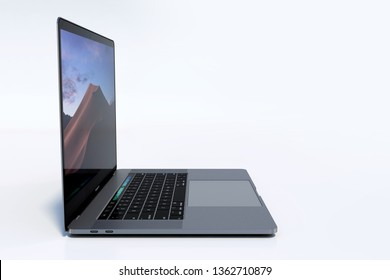 Bucharest, Romania - August 19, 2018: Apple MacBook Pro (MBP) 15 inch Silver laptop computer with lid open, keyboard visible. Lateral perspective. Very high detail, high resolution
