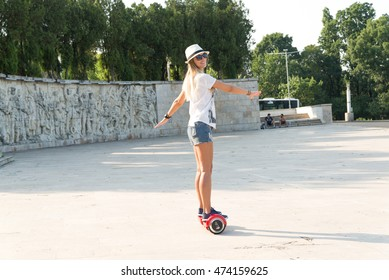 BUCHAREST, ROMANIA, - August 2, 2016: Girl using hoverboard, a self-balancing two-wheeled board, in the park. Editorial content