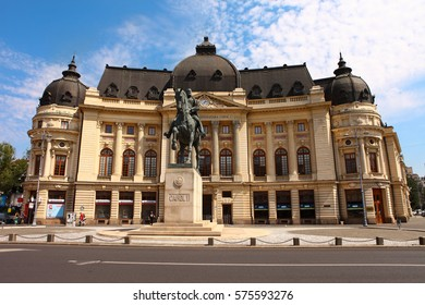 BUCHAREST, ROMANIA - AUGUST 20, 2016: Central University Library and statue of king Carol I of Romania, on Victoria street, Bucharest city centre in a sunny day.