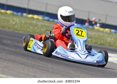 BUCHAREST, ROMANIA - AUGUST 21: Andrei Vajda, number 27, competes in National Karting Championship, Round 5, on August 21, 2011 in Bucharest, Romania.