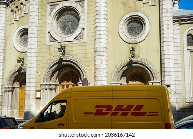 Bucharest, Romania - August 30, 2021 An yellow DHL delivery van is parked in front of the Lutheran church, on Lutheran street in Bucharest.