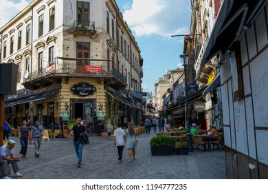 BUCHAREST, ROMANIA - CIRCA JUNE 2016: Unidentified people walk through the streets of the Old Town