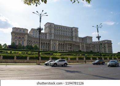 BUCHAREST, ROMANIA - CIRCA JUNE 2016: Cars drive past the Romanian Palace of Parliament