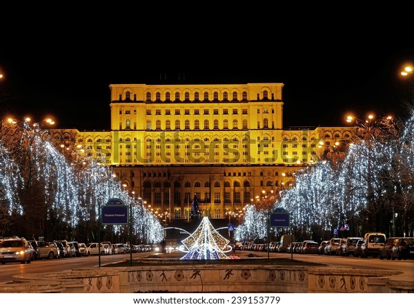 BUCHAREST, ROMANIA - DEC 22: Palace of Parliament on Dec 22, 2014 in Bucharest, Romania. Is the worlds largest civilian building, the most expensive administrative building and heaviest building.