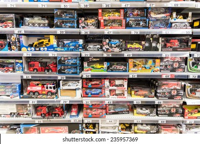 BUCHAREST, ROMANIA - DECEMBER 06, 2014: Car Toys For Small Children On Supermarket Stand.