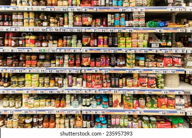 BUCHAREST, ROMANIA - DECEMBER 06, 2014: Canned Food And Special Sauces On Supermarket Stand.