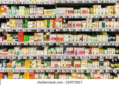 BUCHAREST, ROMANIA - DECEMBER 06, 2014: Medical Pills And Supplements On Pharmacy Stand.