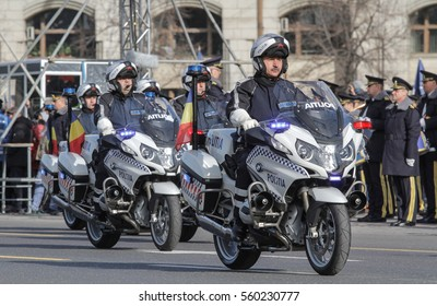 BUCHAREST, ROMANIA, DECEMBER 1, 2015: Police men on motorcycles are marching for the National Day of Romania military parade in Bucharest.