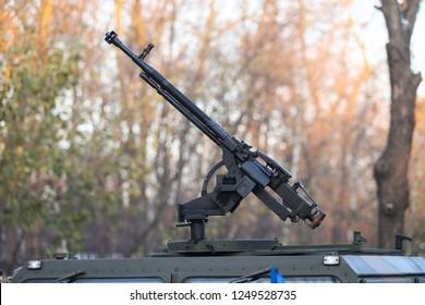 BUCHAREST, ROMANIA - December 1, 2018: 50 cal machine gun mounted on a Humvee military vehicle