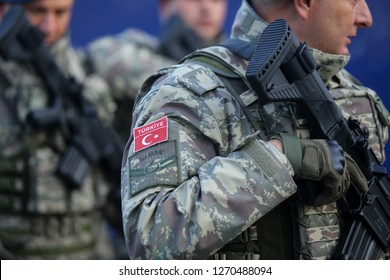 BUCHAREST, ROMANIA - December 1, 2018: Turkish soldiers, holding MPT 76 assault rifles (7.62x51 mm NATO), take part at the Romanian National Day military parade