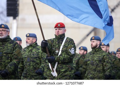 Bucharest, Romania - December 1, 2018: Details with the uniform and flag of Canadian Military Police soldiers taking part at the Romanian National Day military parade.