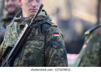 Bucharest, Romania - December 1, 2018: Details with the uniform  German soldiers, armed with Heckler & Koch G36 5.56×45mm NATO assault rifle, taking part at the Romanian National Day military parade.