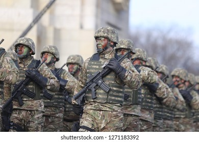 Bucharest, Romania - December 1, 2018: Romanian special forces soldiers, armed with M4A1 5.56×45mm NATO assault rifles with holographic sight, take part at the Romanian National Day military parade.