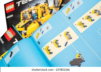 BUCHAREST, ROMANIA - DECEMBER 14, 2014: Lego Technic Instruction Manual. Technic is a line of Lego interconnecting plastic rods and parts that creates more advanced models.