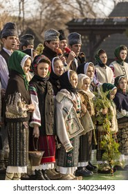 "Bucharest, Romania - December the 14th 2014 - Children and adults in traditional clothing, singing carols, at ""Florile Dalbe"" Traditional Carol Festival held at ""Dimitrie Gusti"" Village Museum."