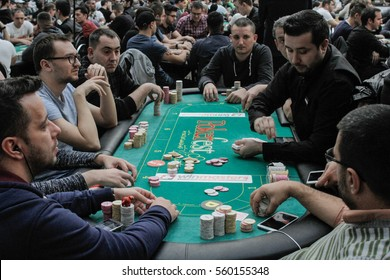 Bucharest, Romania, December 19, 2015: Gamblers are playing poker with chips and cards in a poker festival organized in Bucharest.