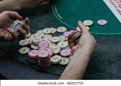 Bucharest, Romania, December 19, 2015: A gambler arranges cards in a poker festival organized in Bucharest.