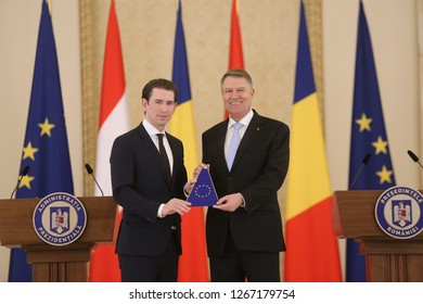 BUCHAREST, ROMANIA - December 21, 2018: Austrian Chancellor Sebastian Kurz shakes hands with Romanian President Klaus Iohannis at the Cotroceni presidential palace in Bucharest.
