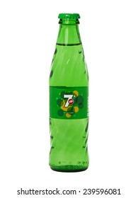 BUCHAREST, ROMANIA  DECEMBER 23, 2014. 7up glass bottle isolated on white background. 7up is a carbonated soft drink that is produced and manufactured by PepsiCo.
