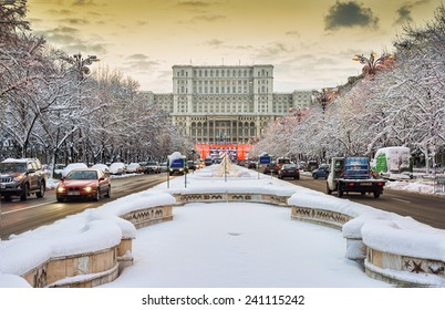 BUCHAREST, ROMANIA - DECEMBER 30, 2014: The Palace of the Parliament (People's Palace) the world's largest civilian building  during winter season with famous fountains under lot of snow