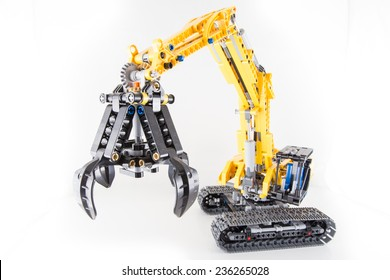 Bucharest, Romania - December 7, 2014: Lego technic excavator on white background.  Lego is a danish toy manufacturer.