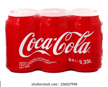 BUCHAREST, ROMANIA - DECEMBER 8, 2014. Six pack of cans of Coca-Cola produced and owned by Coca-Cola Company.