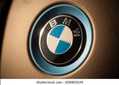 Bucharest, Romania - December 9, 2018: Illustrative editorial image of a BMW logo displayed on a car's steering wheel. BMW is a German car manufacturer.