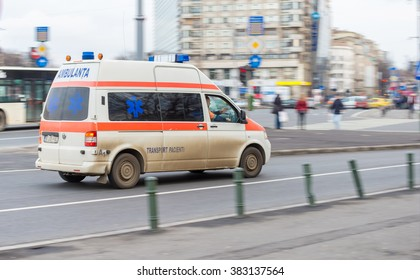 Bucharest, Romania - February 05, 2016: First aid ambulance car driving very fast on city street due to an emergency call.