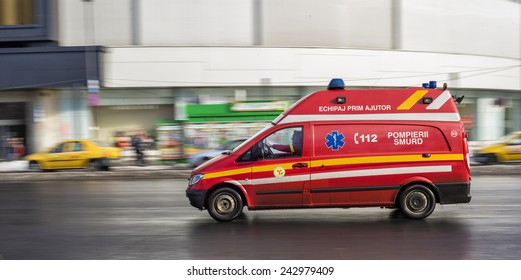 BUCHAREST, ROMANIA - FEBRUARY 10, 2014: First aid car belonging to SMURD, a romanian emergency rescue service, driving very fast on city street due to an emergency call.